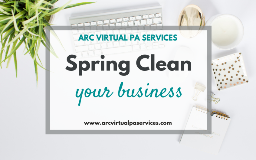 White desk flatlay with text overlay which reads Spring Clean Your Business